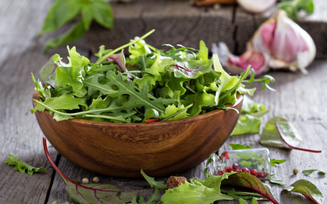 Arugula salad with raspberries in citrus dressing
