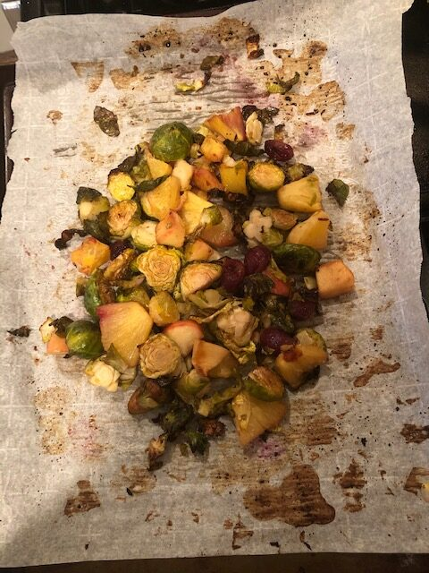Roasted Brussels sprouts with seasonal fruit, soy sauce and ginger